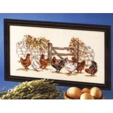 Kippen bij het hek