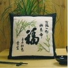 Oosters kussen bamboe en tekens