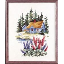 Huis in bos met riddersporen