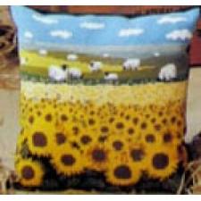 Veld met schapen en zonnebloemen