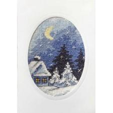 Kerstkaart huisje in sneeuw met halve maan