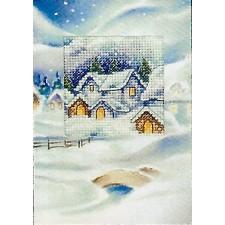 Kerstkaart met huisjes in de sneeuw