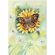 Gele bloem en vlinder